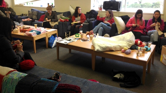 A student common room transforms into a knitting hub. You can almost hear the clicking of the needles.